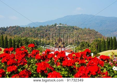Hor Kam Luang with red flower foregroundroyal pavilionChiangmai Thailand.(Public place)