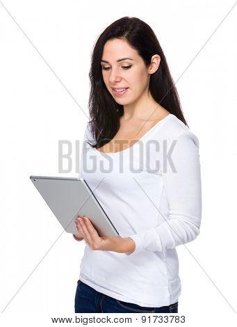 Brunette woman read on tablet