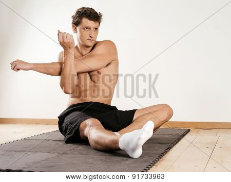 Man Stretching Shoulder Muscles