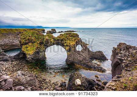 Travel to Iceland in the summer. Picturesque fancy coastal cliffs Arnastapi