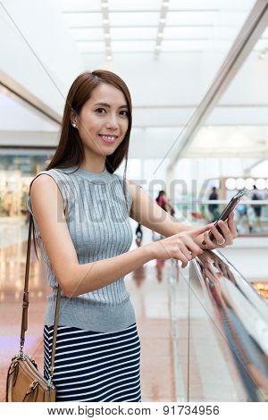 Woman use of cellphone at shopping mall