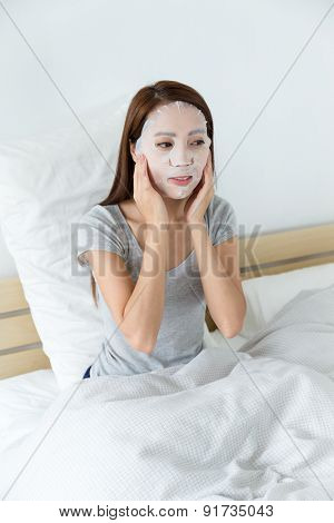 Asian woman do facial making at living room