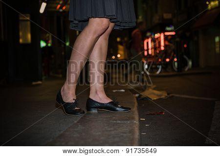 Legs Of Woman Walking Streets At Night