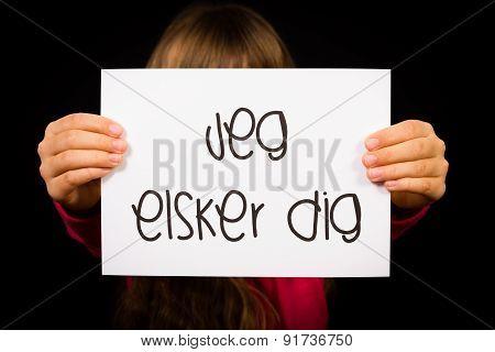 Child Holding Sign With Danish Words Jeg Elsker Dig - I Love You
