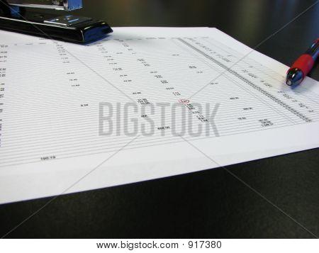 Accountingwithstaplerandpen