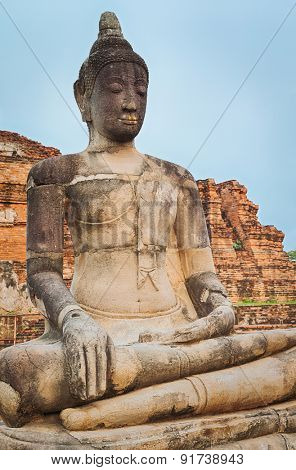 Buddha statue in Wat Mahathat. Ayutthaya historical park. Panorama