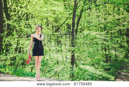 Barefoot Brunette Girl In Black Dress Outdoor