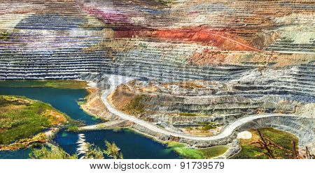 colorful terraces of geological mine in Milos island, Greece