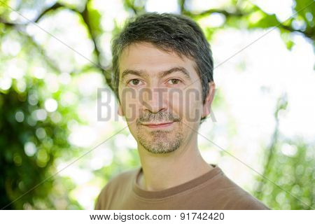 young happy casual man portrait, outdoors, bokeh picture