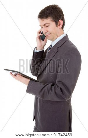 businessman using touch pad of tablet pc on the phone, isolated