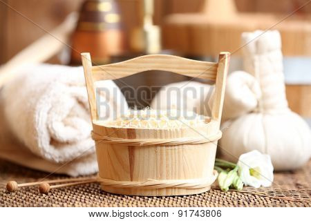 Beautiful spa composition with flowers on table close up