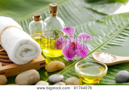 Spa setting on banana leaf with orchid
