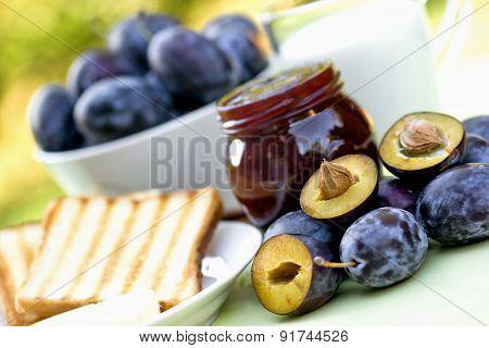 Plum jam, toast and milk