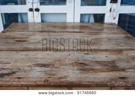 Wood Table Against Old Door