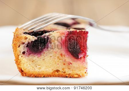 Piece Of Blueberry Pie In White Plate With Fork