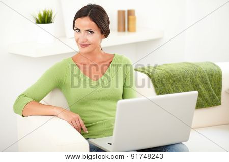 Relaxed Caucasian Woman Using A Laptop