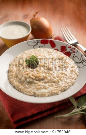 risotto with onion  cream sauce and sage, selective focus