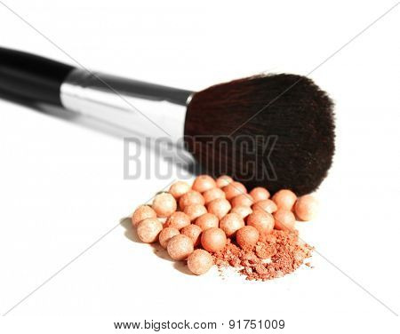 Cosmetic powder balls and makeup brush, isolated on white