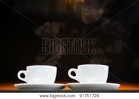 Two white cups with hot drinks
