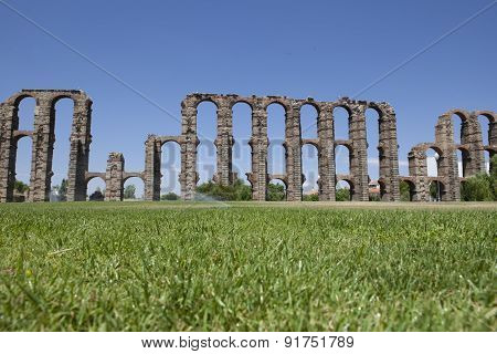 Aqueduct Of Merida From The Grass