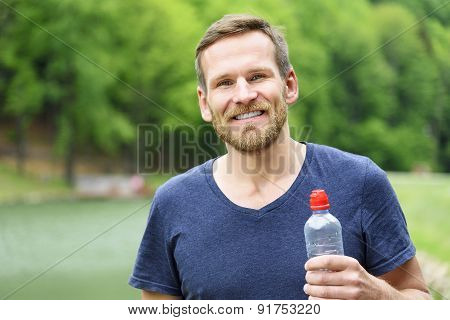 Sportsman With A Bottle Of Water.