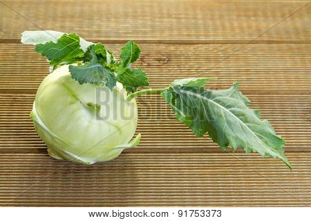 Fresh raw kohlrabi on a wooden table