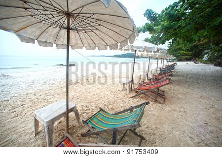 Umbrellas And Bed Rest On The Beach.