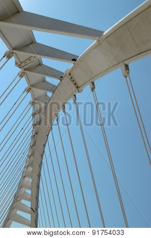 Abstract shape of a white bridge. Vertical