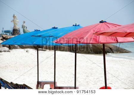Umbrellas And beach chairs On The Beach.
