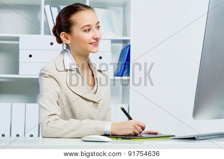 Attractive photo editor working on computer in a modern office