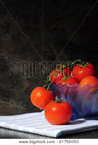 Still Life Closeup Of Bright Red Tomatoes In Blue Vintage Bowl