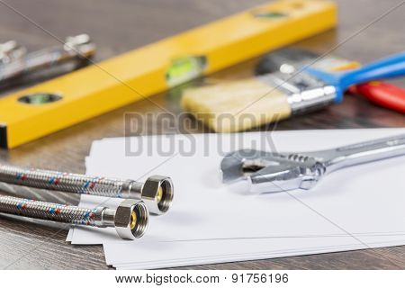 All kinds of plumbing and tools on sheet of paper