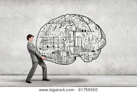Young businessman carrying out ideas of business plan