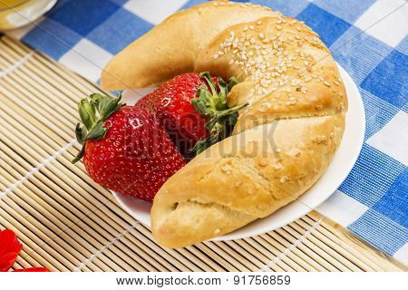 Breakfast with assortment of pastries, coffees and fresh strawberries