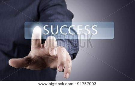 Close up of businessman pushing success icon on media screen