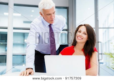 Businessman and young female employee in office