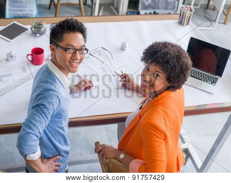 Two desingers working on a project together in office