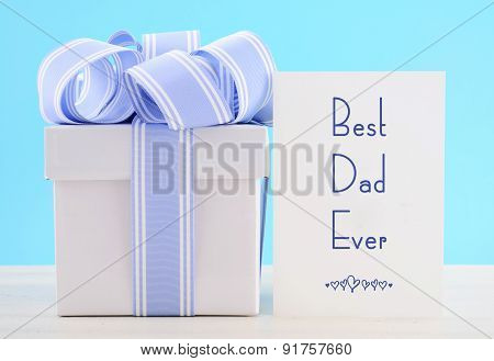 Happy Fathers Day Gift With Blue And White Ribbon