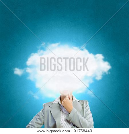 Businesswoman standing with his head in cloud