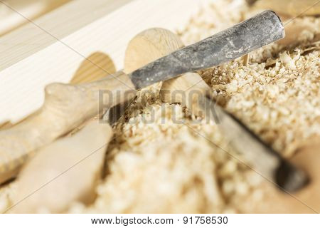 Cutters for wood and wood shavings on table