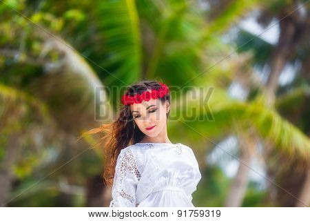 Young Beautiful Woman Relaxing Under The Palm Tree In A Hotel On A Tropical Island. Summer Vacation