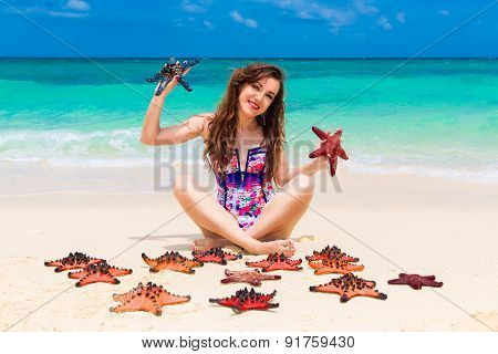 Beautiful Young Brunette Enjoying The Sun On The Tropical Coast Of Red Sea Stars