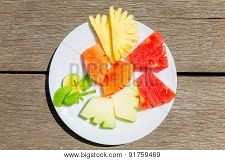 Delicious Breakfast Of Fresh Fruit On A Plate - Watermelon, Melon, Lime, Papaya, Pineapple And Mint