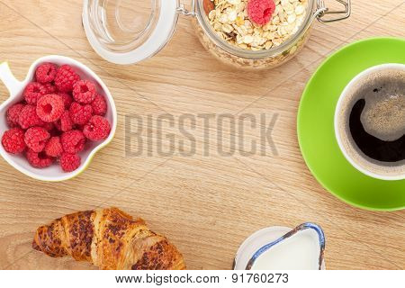 Healthy breakfast with muesli, berries and milk. On wooden table with copy space