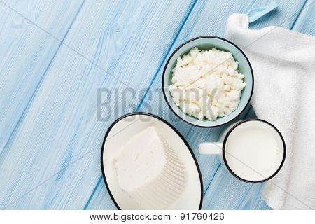 Dairy products on wooden table. Milk, cheese and curd cheese. Top view with copy space