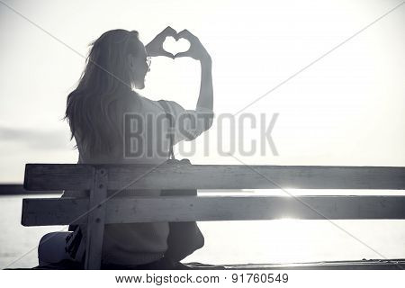 Woman Showing Heart Symbol.