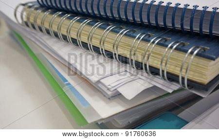 Stack Of Office Document And Ring Binder Book On Desk