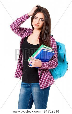 Cute girl with books and bag, isolated on white background
