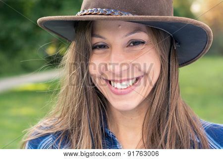 Brunette cowgirl smiling