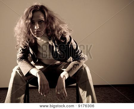 Woman Sitting On The Chair And Looking To The Camera